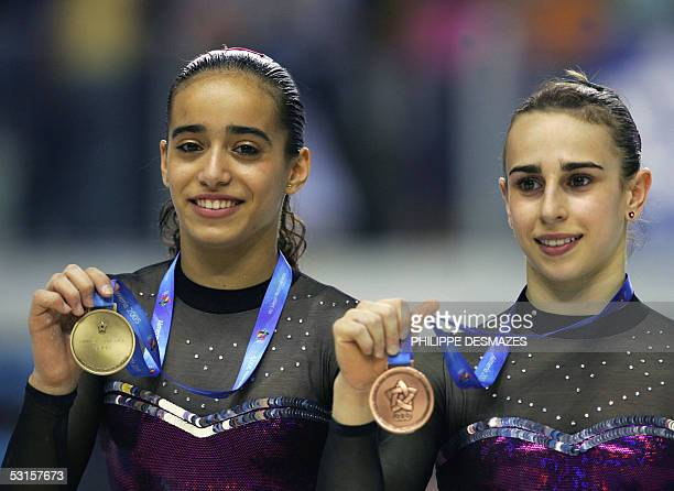 Spanish Tania Gener Cordero and Lenika de Simone Blanco show their medals after their uneven bars final of the gymnastics event during the XV...