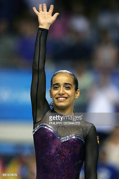 Spanish Tania Gener Cordero salutes thr audience after winning the women's uneven bars gymnastics final of the XV Mediterranean Games 27 June 2005 at...