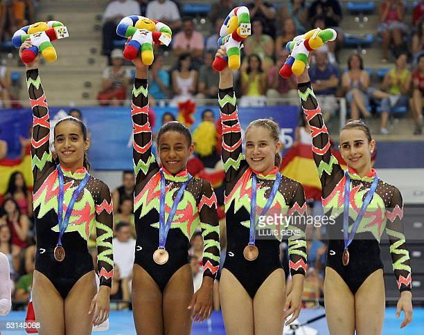 Spanish Tania Gener Cordero Thais Escolar Ela Melodi Pulgarin Linero and Lenika de Simone Blanco celebrate after winning the bronze medal of the...