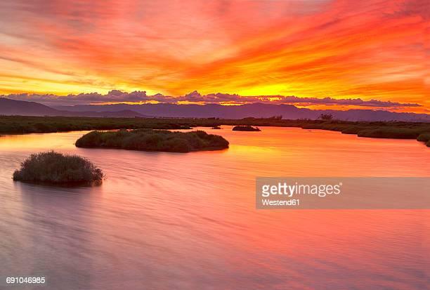 spain, tarragona, ebro delta, tancada lagoon at sunset - ebro river stock photos and pictures