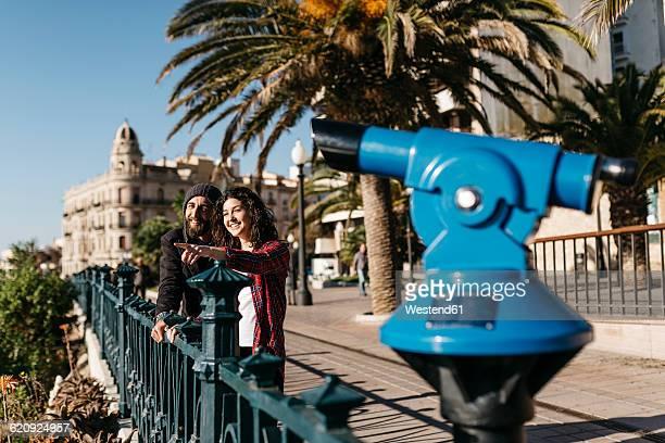 Spain, Tarragona, young couple exploring the city