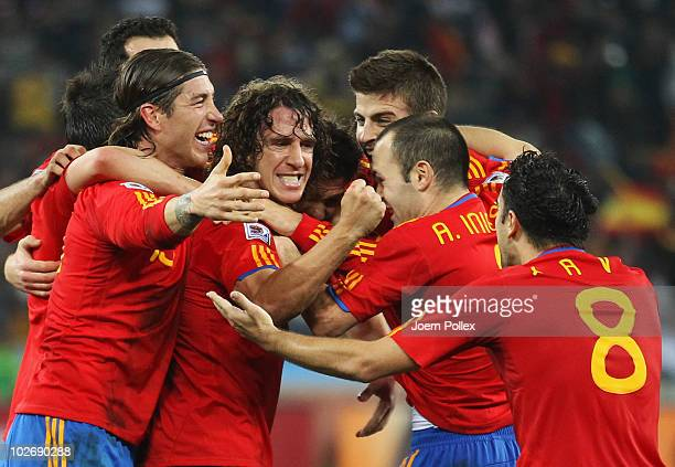 Spain team mates celebrate the opening goal scored by Carles Puyol during the 2010 FIFA World Cup South Africa Semi Final match between Germany and...