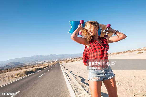 Spain, Tenerife, blond young skater with skateboard