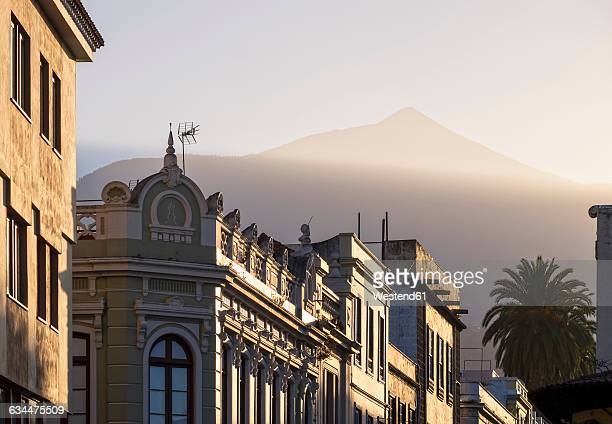 Spain, Tenerife, La Orotava, house facades at evening twilight with Mount Teide in the background