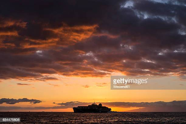 Spain, Tenerife, Ship on the ocean at sunset