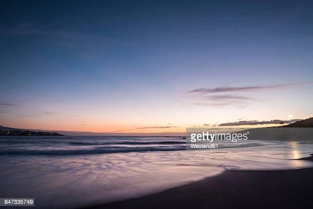 Spain, Tenerife, Sunrise at the ocean