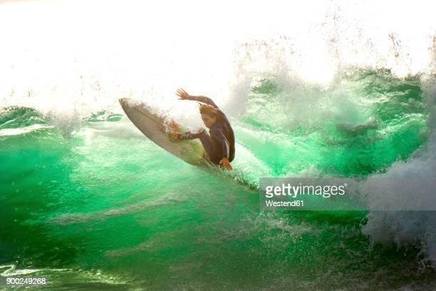 spain, tenerife, surfer on the ocean - brandung stock-fotos und bilder