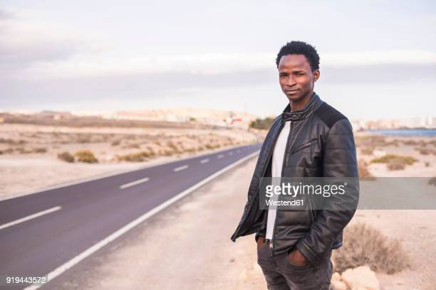 Spain, Tenerife, young man standing on road