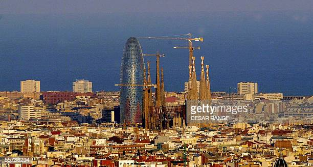The Sagrada Familia of the architect Antoni Gaudi and the new Agbar Tower in Barcelona, 21 September 2005 following its inauguration by Spanish King...
