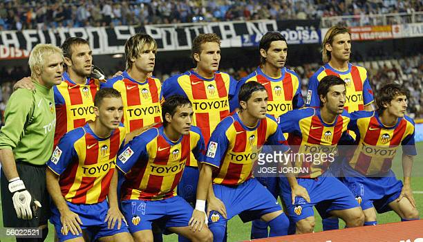 The Valencian squad pose in their new strip prior to a Spanish league match against Sevilla in Valencia 27 October 2005 The Spanish champions have...