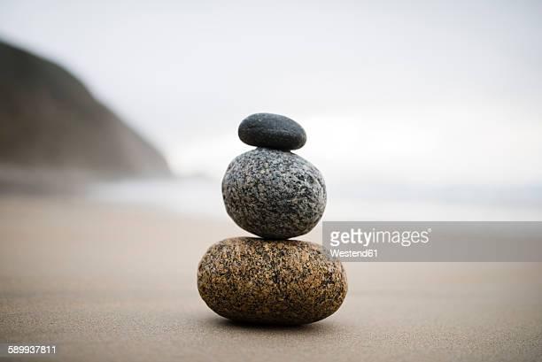 Spain, three rocks balanced on the beach