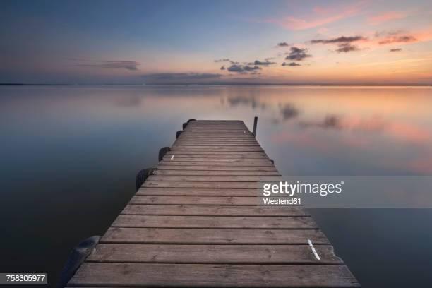 Spain, Valencia, La Albufera, empty jetty at sunset