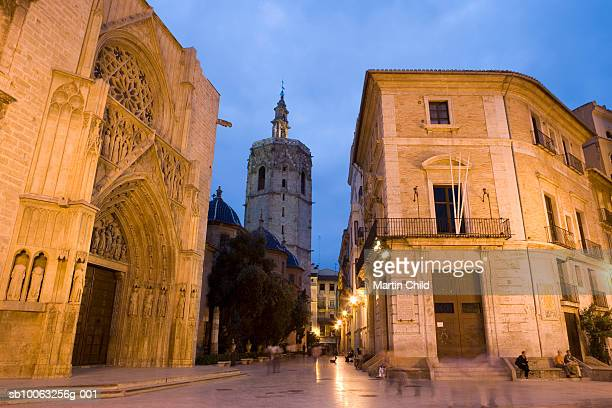 Spain, Valencia, Plaza de La Virgen with the cathedral and el Miguelet tower at evening