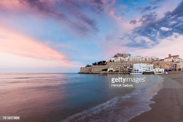 Spain, Valencian Community, Peniscola, Waterfront town at sunset