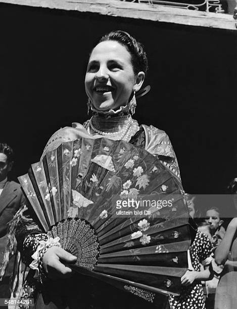 Spain ValenciaRegion Valencia Spanish woman with big colorful fan 1940 Photographer Regine Relang Published by 'Die Dame' 17/1940 Vintage property of...