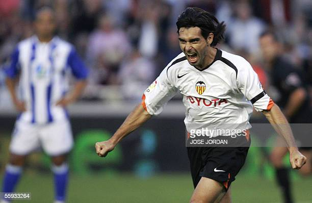 Valencia's Argentinian Fabian Ayala celebrates after scoring against Malaga during their Spanish League match at the Mestalla stadium in Valencia 16...