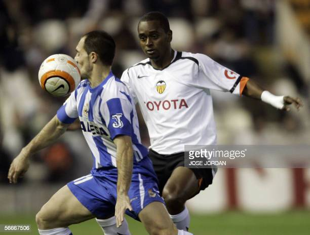 Valencia's Portuguese Miguel Brito fights for the ball with Deportivo's Pedro Munitis during their Spanish King Cup football match at the Mestalla...