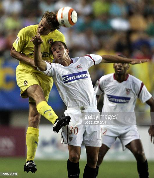 Villarreal's Dutch Jan Kromkamp fights for the ball with Seville's Kepa Blanco during their Spanish League match at the Madrigal stadium in...