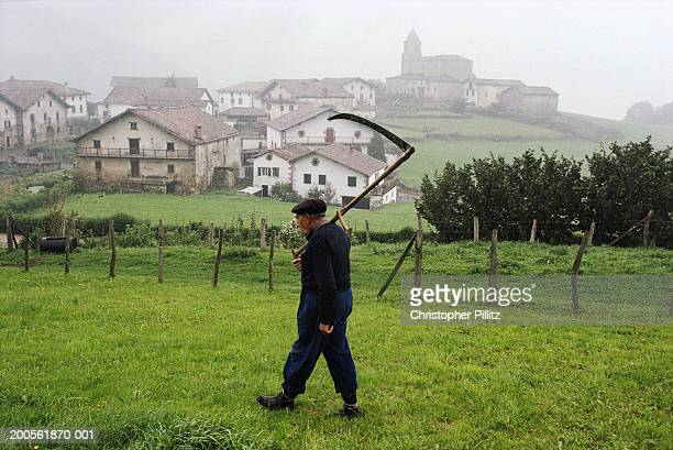 Spain,Berroeta village,Basque country,farmer walking in field