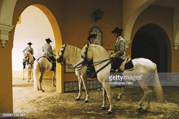 Spain,Jerez de la Frontera,School of Equestrian Art,four men on horses.