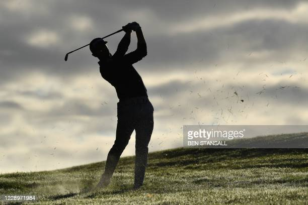 Spain's Adri Arnaus plays the second shot on the 1st hole on Day 2 of the PGA Championship at Wentworth Golf Club in Surrey, south west of London on...