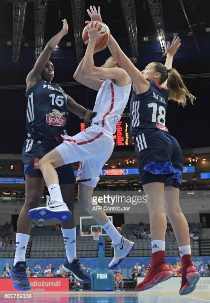 Spain's Alba Torrens and France's Hhadydia Minte and Alexia Chartereau vie for a ball during the FIBA EuroBasket 2017 women's final match between...