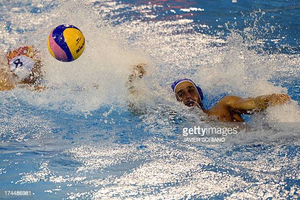 Spain's Albert Espanol vies with Greece's Evangelos Ioannis Delakas during their preliminary round match Spain vs Greece of the men's water polo...
