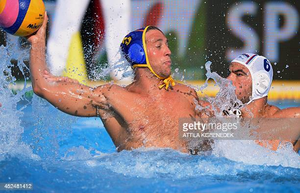 Spain's Albert Espanol vies with Serbian Dusko Pijetlovic during the men's Water Polo European Championships match Serbia vs Spain in Budapest on...