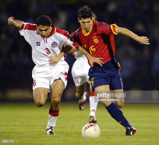 Spain's Albert Luque vies for the ball with Armenia's Karen Dorkhoyan during their Euro 2004 qualifier match at Vazgen Sargsyan stadium in Yerevan 11...