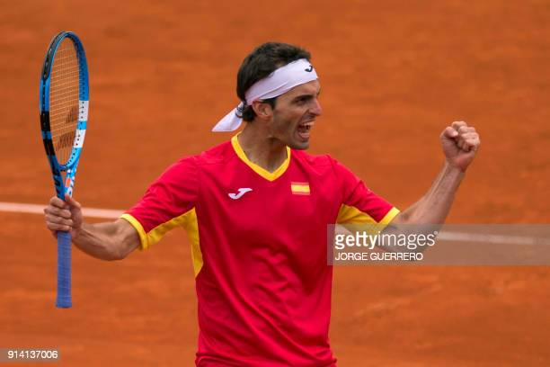 Spain's Albert Ramos celebrates after winning against British Cameron Norrie the first round of the Davis Cup tennis match between Spain and Great...