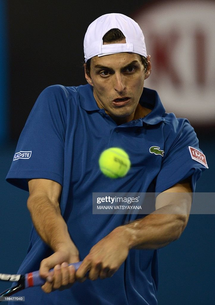 Spain's Albert Ramos hits a return against Cyprus's Marcos Baghdatis during their men's singles first round match on day one of the Australian Open tennis tournament in Melbourne on January 14, 2013.