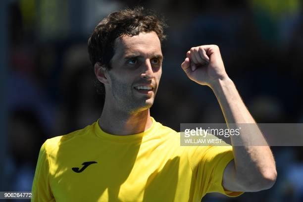 Spain's Albert RamosVinolas celebrates beating Tim Smyczek of the US in their men's singles second round match on day four of the Australian Open...