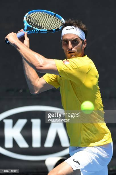 Spain's Albert RamosVinolas hits a return against Tim Smyczek of the US during their men's singles second round match on day four of the Australian...
