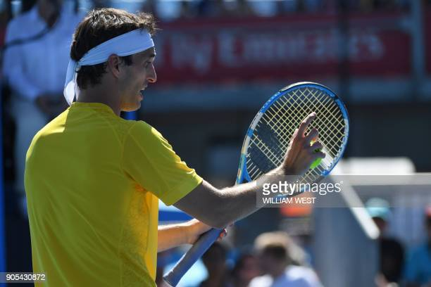 Spain's Albert RamosVinolas reacts after a point against Jared Donaldson of the US during their men's singles first round match on day two of the...