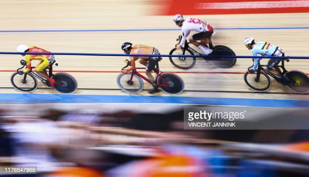 Spain's Albert Torres Barcelo Netherlands' Jan Willem van Schip Switzerland's Claudio Imhof and Belgium's Lindsay de Vylder compete in the omnium...