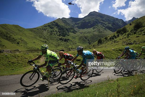 TOPSHOT Spain's Alberto Contador Australia's Richie Porte Italy's Fabio Aru and USA's Tejay Van Garderen ride in the pack during the 184 km eighth...