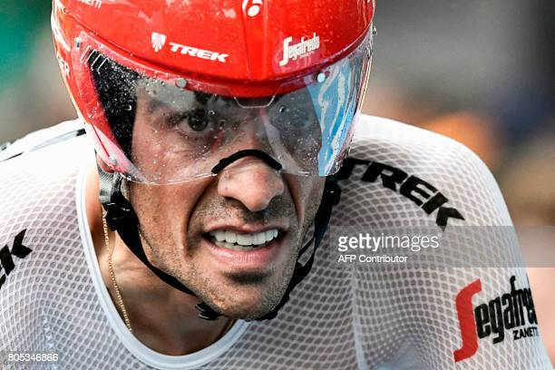Spain's Alberto Contador crosses the finish line during a 14 km individual timetrial the first stage of the 104th edition of the Tour de France...