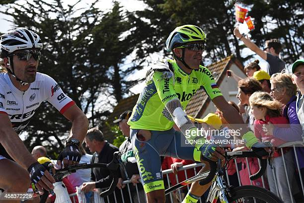 Spain's Alberto Contador , injured, reacts after crossing the finish line, next to Switzerland's Fabian Cancellara at the end of the 188 km first...