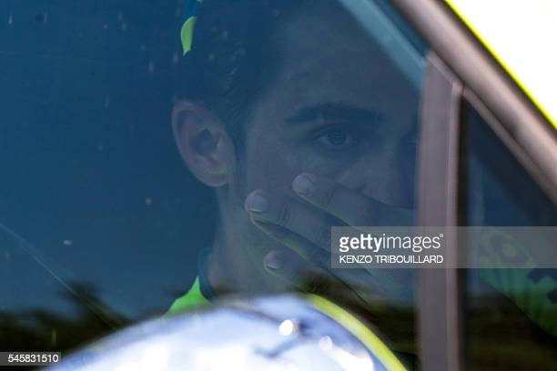 TOPSHOT Spain's Alberto Contador is pictured inside his team car after he drops out of the 1845 km ninth stage of the 103rd edition of the Tour de...