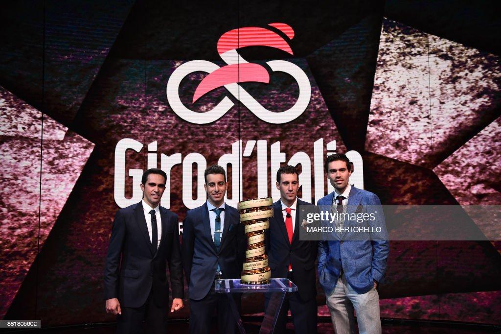 Spain's Alberto Contador (L), Italy's Fabio Aru (2nd L), Giro d'Italia director Mauro Vegni (C), Italy's Vincenzo Nibali and Giro's title holder Tom Dumoulin (R) of Netherlands attend the presentation of the 2018 Tour of Italy (101st Giro d'Italia) cycling race, on November 29, 2017 in Milan. /