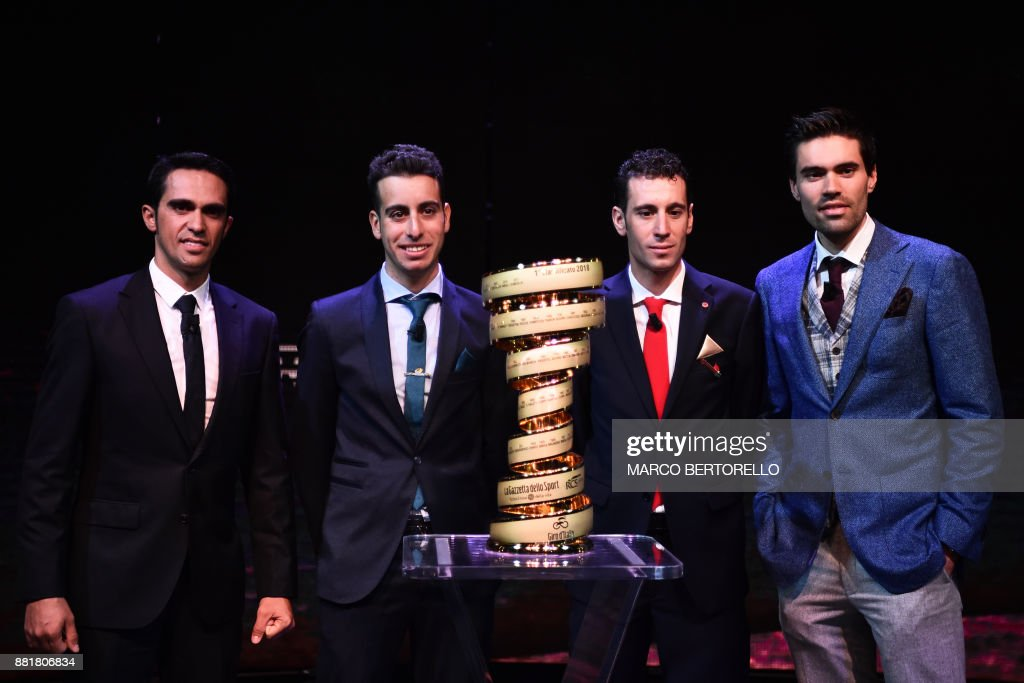 Spain's Alberto Contador (L), Italy's Fabio Aru (2ndL), Italy's Vincenzo Nibali and Giro's title holder Tom Dumoulin (R) of Netherlands attend the presentation of the 2018 Tour of Italy (101st Giro d'Italia) cycling race, on November 29, 2017 in Milan. /