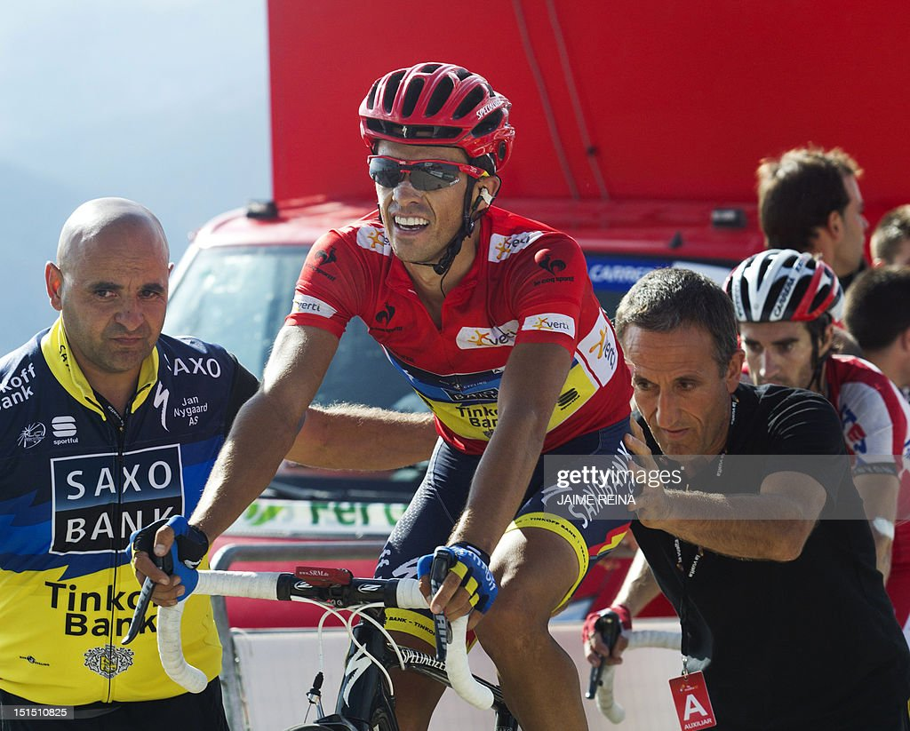 f48187bc3 Spain s Alberto Contador of the Saxo Bank-Tinkoff Bank Team is pushed by  supporters on the finish line of the 20th stage of the Vuelta tour of  Spain