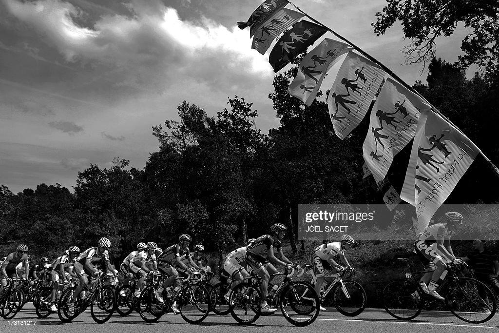 Spain's Alberto Contador rides as flags of the anti-gay