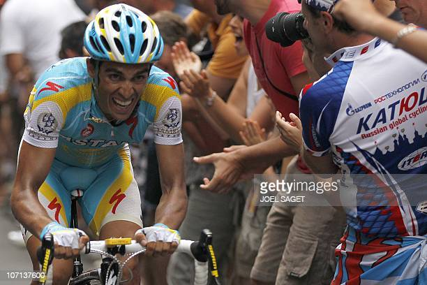 Spain's Alberto Contador rides at the end of the 210,5 km and 12th stage of the 2010 Tour de France cycling race run between Bourg-de-Peage and...