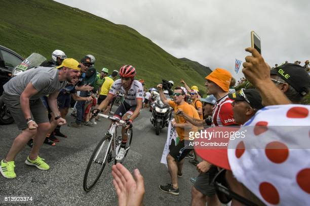 TOPSHOT Spain's Alberto Contador rides in a breakaway as supporters cheer during the 2145 km twelfth stage of the 104th edition of the Tour de France...