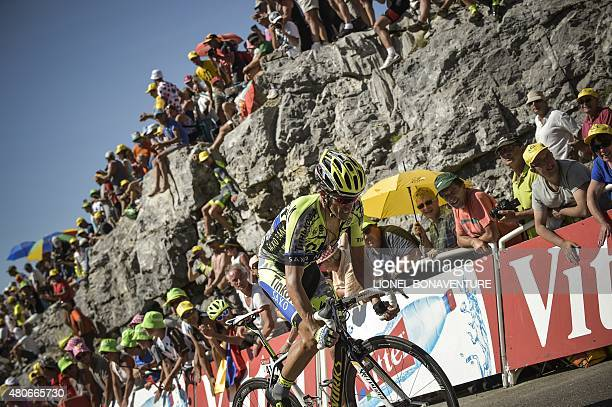 Spain's Alberto Contador rides in the last hill during the 167 km tenth stage of the 102nd edition of the Tour de France cycling race on July 14...