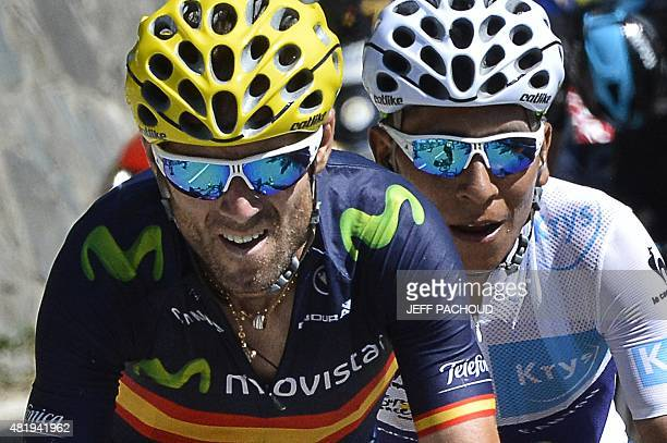 Spain's Alejandro Valverde and Colombia's Nairo Quintana wearing the best young's white jersey ride in a breakaway during the 1105 km twentieth stage...