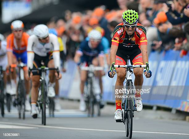 Spain's Alejandro Valverde crosses the finish line in third place at the end of the Men Elite Road World Championships on September 23 2012 in...