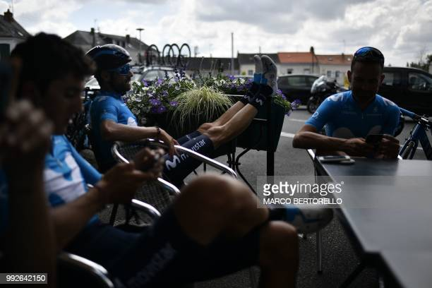 Spain's Alejandro Valverde relaxes at a cafe terrace with his Spain's Movistar Team cycling team teammates within a training session on July 6, 2018...
