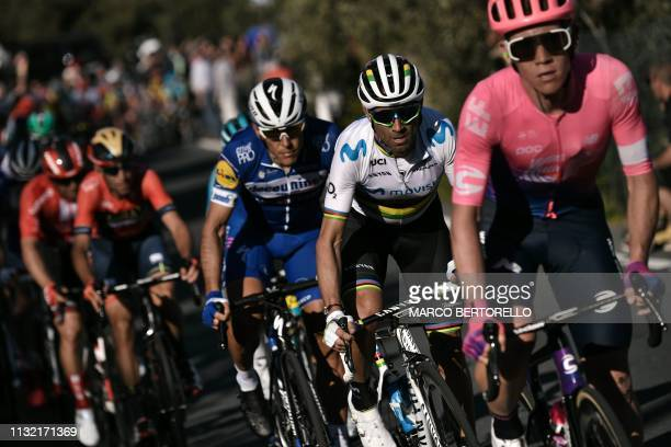 Spain's Alejandro Valverde rides with the pack in the Cipressa ascent during the oneday classic cycling race Milan San Remo on March 23 2019